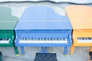 Light blue, orange, piano green toy
