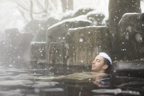 Men relaxing soak in the winter of hot spring