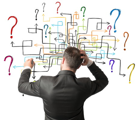 Businessman trying to solve a maze questions