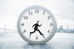 Time management concept with running businessman inside clock on foggy city background. 3D Rendering