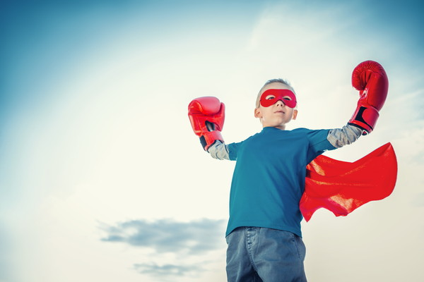 Little boy with boxing gloves outdoors