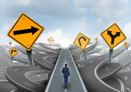 Businessman walking around confusion and chaos on a straight easy path and journey to success as a business metaphor for leadership solution to financial challenges.