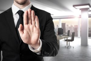 businessman in modern office room hand stop gesture