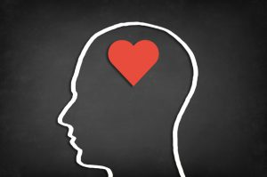 Heart shape in human head. Concept of love.