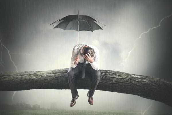 desperate man crying under rain