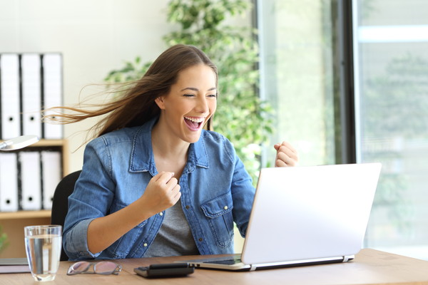 Excited entrepreneur working on line