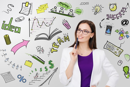 Portrait of businesswoman in eyeglasses pensive looking at her business plan
