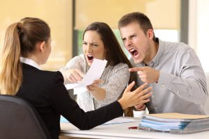 Angry couple claiming at office